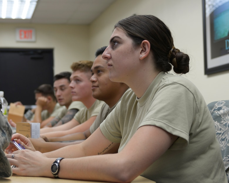 Airman Audra Young, 36th Wing Public Affairs broadcast journalist, listens to a briefing during the Airmanship 300 course June 7, 2017, at Andersen Air Force Base, Guam. Airmanship 300 is the new First Term Airmen's Course that new Airmen are required to attend upon arrival at their new installation. (U.S. Air Force photo by Senior Airman Cierra Presentado/Released)