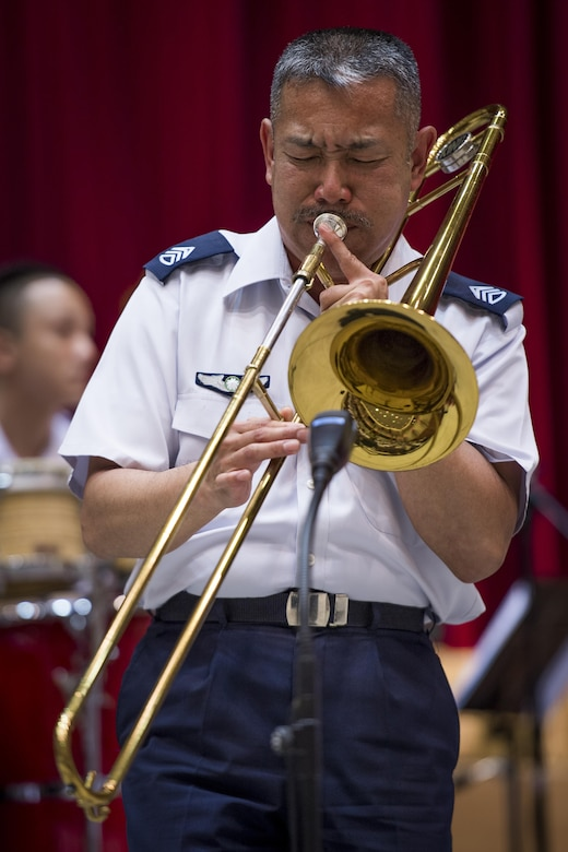 Japan Air Self Defense Force Chief Master Sgt. Takahiro Arai, JASDF Central Band bandsman, preforms a trombone solo during a Joint Big Band Concert, June 7, 2017, at the Japanese Ministry of Defense, Tokyo, Japan. The concert marked the first time five separate bands from Japan and U.S. forces have come together as one. By highlighting the strong alliance and friendship shared between the Japanese and U.S. forces, the concert demonstrated how music can help strengthen cultural ties. (U.S. Air Force photo by Airman 1st Class Donald Hudson)