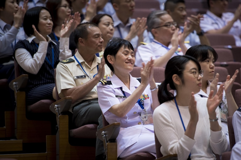 Audience members applaud the performance during a Joint Big Band Concert, June 7, 2017, at the Japanese Ministry of Defense, Tokyo, Japan. The Joint Big Band is scheduled to perform at local high schools in Tokyo to show how music can cross cultural barriers and demonstrate the cooperation and friendship between Japan and U.S. forces. (U.S. Air Force photo by Airman 1st Class Donald Hudson)