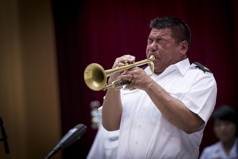 U.S. Army Staff Sgt. Joel Heredia, U.S. Army Japan Band Camp Zama bandsman, preforms a trumpet solo during a Joint Big Band Concert, June 7, 2017, at the Japanese Ministry of Defense, Tokyo, Japan. The concert marked the first time five separate bands from Japan and U.S. forces have come together as one. By highlighting the strong alliance and friendship shared between the Japanese and U.S. forces, the concert demonstrated how music can help strengthen cultural ties. (U.S. Air Force photo by Airman 1st Class Donald Hudson)