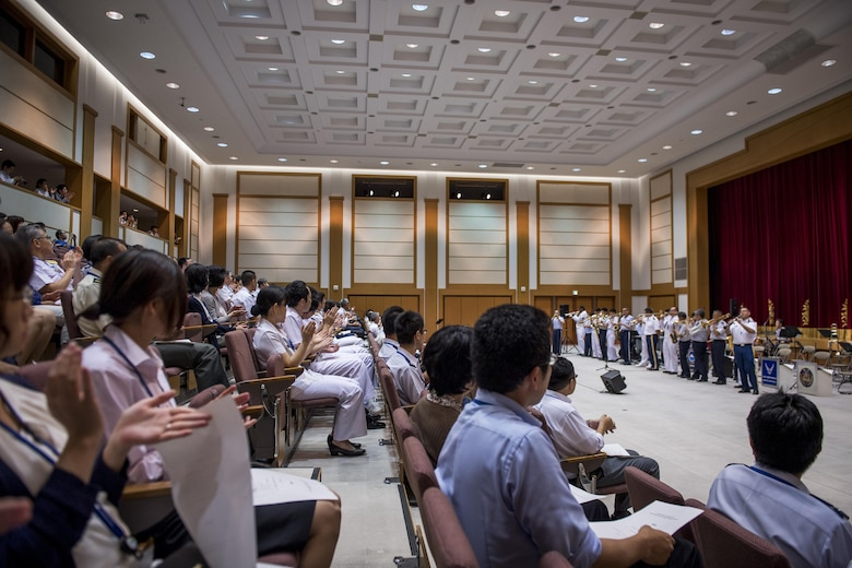"""During a concert audience members clap along with the band as they play the song, """"When the Saints Come Marching In,"""" June 7, 2017, at the Japanese Ministry of Defense, Tokyo, Japan. The Joint Big Band included 20 members of Japanese and U.S. forces from across five different bands: the Tokyo Band Sea Legs, Japan Air Self Defense Force Central Band, U.S. Army Japan Band Camp Zama, U.S. Navy 7th Fleet Band and the U.S. Air Force Band of the Pacific. (U.S. Air Force photo by Airman 1st Class Donald Hudson)"""