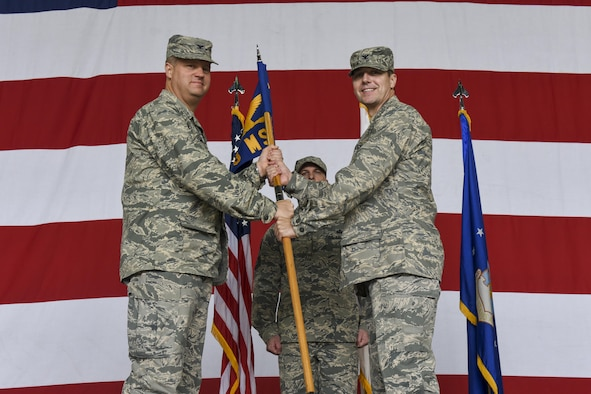 U.S. Air Force Col. Michael Zuhlsdorf, 8th Mission Support Group commander, receives the guidon from Col. David Shoemaker, 8th Fighter Wing commander, during a change of commander ceremony at Kunsan Air Base, Republic of Korea, June 8, 2017. Col. Shoemaker presided over the ceremony in which Col. Richard McKee relinquished command of the 8th MSG to Col. Michael Zuhlsdorf. (U.S. Air Force photo by Senior Airman Michael Hunsaker/Released)