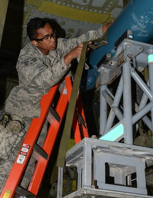 U.S. Air Force Senior Airman Aldrin Magalong, 2nd Aircraft Maintenance Squadron load crew team chief, secures BDU-50s (inert munitions) general purpose unguided conventional weapons to a bomb lift truck at RAF Fairford, U.K., June 5, 2017. Load crews are participating in Saber Strike 2017, an annual, multinational, exercise designed to strengthen interoperability and cohesiveness between NATO allies and partner nations. (U.S. Air Force photo/Senior Airman Curt Beach)