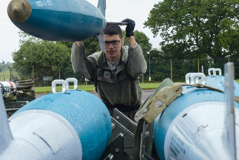 U.S. Air Force Senior Airman Michael Ruiz, 2nd Aircraft Maintenance Squadron load crew team member, guides BDU-50s (inert munitions) general purpose unguided conventional weapons at Royal Air Force Fairford, U.K., June 5, 2017. Load crews are participating in Saber Strike 2017, an annual, multinational, exercise designed to strengthen interoperability and cohesiveness between NATO allies and partner nations. (U.S. Air Force photo/Senior Airman Curt Beach)