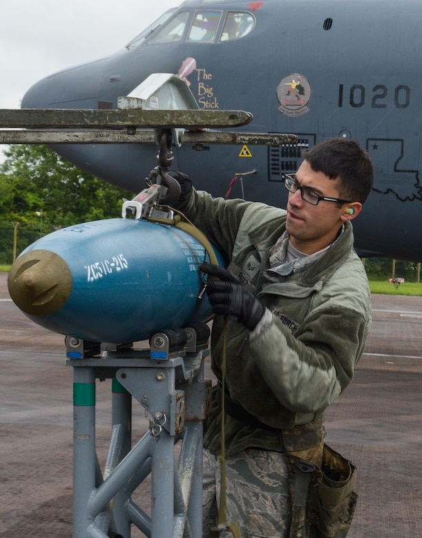 U.S. Air Force Senior Airman Michael Ruiz, 2nd Aircraft Maintenance Squadron load crew team member, fastens a BDU-50 (inert munition) general purpose unguided conventional weapon to a bomb lift truck at Royal Air Force Fairford, U.K., June 5, 2017. Load crews are participating in Saber Strike 2017, an annual, multinational, exercise designed to strengthen interoperability and cohesiveness between NATO allies and partner nations. (U.S. Air Force photo/Senior Airman Curt Beach)