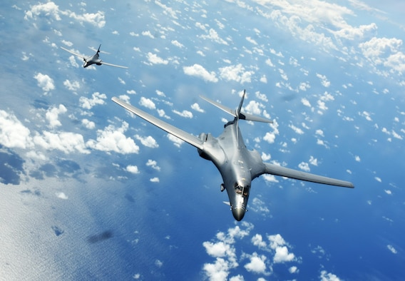 Two U.S. Air Force B-1B Lancers assigned to the 9th Expeditionary Bomb Squadron, deployed from Dyess Air Force Base, Texas, fly a 10-hour mission from Andersen Air Force Base, Guam, through the South China Sea, operating with the U.S. Navy's Arleigh Burke-class guided-missile destroyer USS Sterett (DDG 104), June 8, 2017. The joint training, organized under Pacific Command's continuous bomber presence program (CBP), allows the Air Force and Navy to increase interoperability by refining joint tactics, techniques and procedures while simultaneously strengthening their ability to seamlessly integrate their operations. (U.S. Air Force photo/Tech. Sgt. Richard P. Ebensberger)