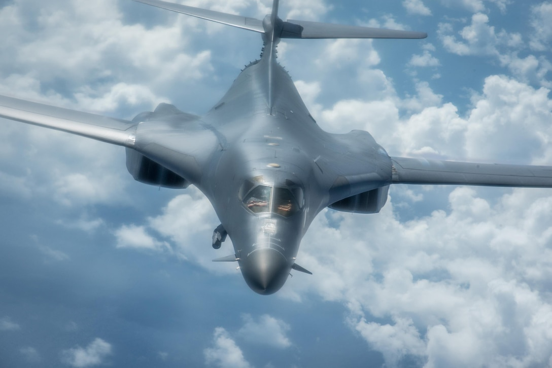 A U.S. Air Force B-1B Lancer assigned to the 9th Expeditionary Bomb Squadron, deployed from Dyess Air Force Base, Texas, flies a 10-hour mission from Andersen Air Force Base, Guam, through the South China Sea, operating with the U.S. Navy's Arleigh Burke-class guided-missile destroyer USS Sterett (DDG 104), June 8, 2017. The joint training, organized under Pacific Command's continuous bomber presence program (CBP), allows the Air Force and Navy to increase interoperability by refining joint tactics, techniques and procedures while simultaneously strengthening their ability to seamlessly integrate their operations. (U.S. Air Force photo/Staff Sgt. Joshua Smoot)