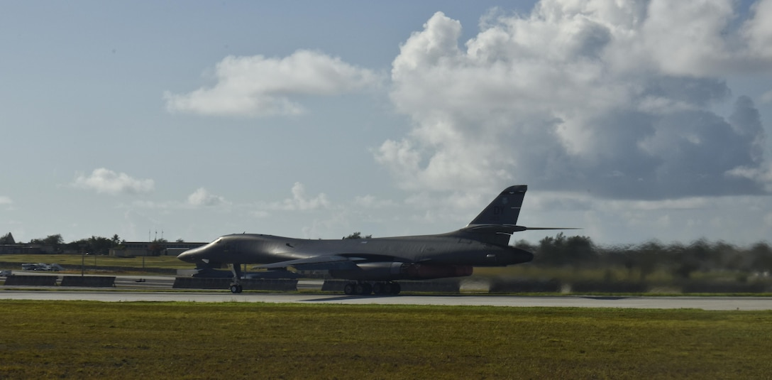 A U.S. Air Force B-1B Lancer assigned to the 9th Expeditionary Bomb Squadron, deployed from Dyess Air Force Base, Texas, takes off from Andersen Air Force Base, Guam, for a 10-hour mission through the South China Sea, operating with the U.S. Navy's Arleigh Burke-class guided-missile destroyer USS Sterett (DDG 104), June 8, 2017. The joint training, organized under U.S. Pacific Command's continuous bomber presence (CBP), allows the Air Force and Navy to increase interoperability by refining joint tactics, techniques and procedures while simultaneously strengthening the ability to seamlessly integrate operations. (U.S. Air Force photo/Tech. Sgt. Richard P. Ebensberger)