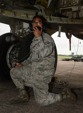 U.S. Air Force Senior Airman Aldrin Magalong, 2nd Aircraft Maintenance Squadron load crew team chief, communicates with team members during a weapons download at Royal RAF Fairford, U.K., June 5, 2017. Load crews are participating in Saber Strike 2017, an annual, multinational, exercise designed to strengthen interoperability and cohesiveness between NATO allies and partner nations. (U.S. Air Force photo/Senior Airman Curt Beach)
