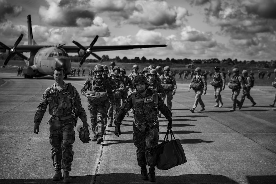 U.S. Air Force C-130J Super Hercules assigned to the 37th Airlift Squadron at Ramstein Air Base, Germany, at Cherbourg-Maupertus Airport, France, June 4, 2017. The modern-day paratroopers recreated air drops similar to the ones on D-Day, June 6, 1944. This event commemorates the 73rd anniversary of D-Day, the largest multinational amphibious landing and operational military airdrop in history, and highlights the U.S.' steadfast commitment to European allies and partners. Overall, approximately 400 U.S. service members from units in Europe and the U.S. are participating in ceremonial D-Day 73 events from May 31-June 7, 2017. (U.S. Air Force photo by Senior Airman Devin Boyer)