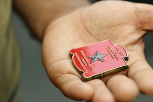 vt. Mohammad Nadir holds a challenge coin given to him by Marine Corps Gen. William Jurney, commanding general for Western Recruiting Region, Marine Corps Recruiting Command, June 1, 2017. Nadir graduated from recruit training on May 26, 2017, and will train to become an infantryman. Nadir moved to the United States in 2014 with a Special Immigrant Visa after working for three years as an interpreter with the International Security Assistance Force in the Sangin District of Helmand province, Afghanistan. (U.S. Marine Corps photo by Sgt. Jessica Quezada)