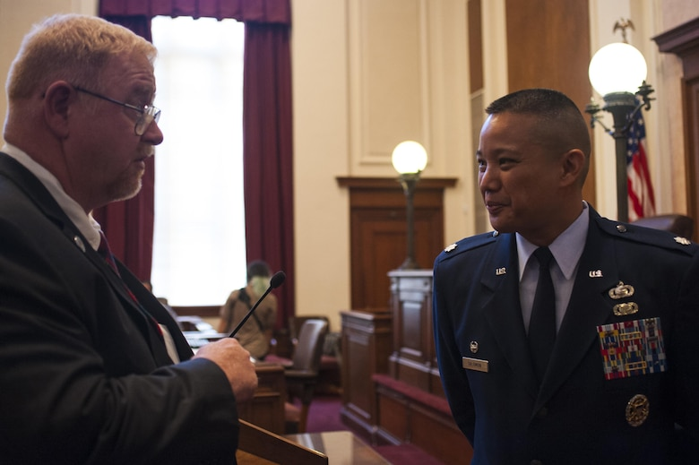 Eric Holman, San Angelo court district adjudications officer, talks with Lt. Col. Abraham Salomon, 17th Training Support Squadron commander, at the the naturalization ceremony in the O.C. Fisher Building, San Angelo, Texas, June 7, 2017. Solomon is a first generation immigrant from the Philippines. (U.S. Air Force photo by Senior Airman Scott Jackson/Released)