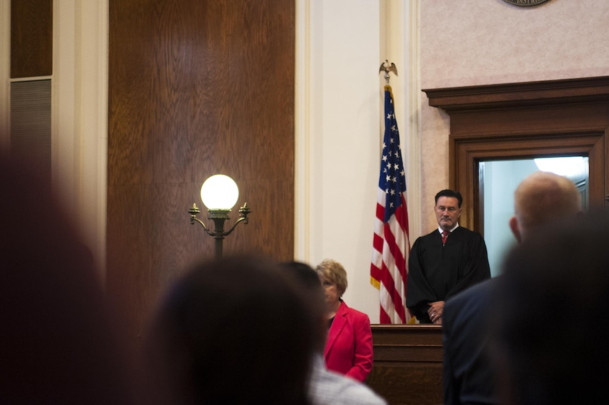 U.S. Magistrate Judge E. Scott Frost, Northern District of Texas San Angelo Division, provides opening remarks for the naturalization ceremony in the O.C. Fisher Building, San Angelo, Texas, June 7, 2017. Frost presided over the ceremony, swearing in 22 new citizens. (U.S. Air Force photo by Senior Airman Scott Jackson/Released)