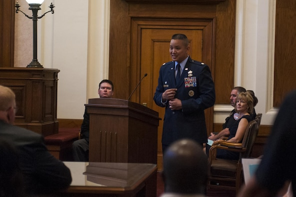 U.S. Air Force Lt. Col. Abraham Salomon, 17th Training Support Squadron commander, speaks to the new naturalized citizens of America in the O.C. Fisher Building, San Angelo, Texas, June 7, 2017. Salomon talked about how honored he was to give the speech and how important this day in their lives is. (U.S. Air Force photo by Senior Airman Scott Jackson/Released)