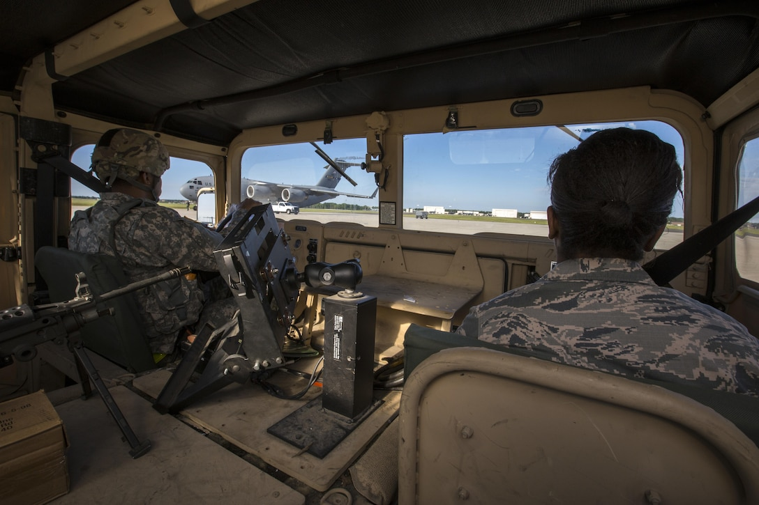 U.S. Army Spc. Anthony R. Cariola, left, 851st Transportation Detachment, U.S. Army Reserve, and U.S. Air Force Senior Airman Krystin A. Springer-Ince, 35th Aerial Port Squadron, 514th Air Mobility Wing, drive a Humvee onto the flight line prior to loading it on a U.S. Air Force C-17 Globemaster III during a joint mobility exercise with the 851st at Joint Base McGuire-Dix-Lakehurst, N.J., June 4, 2017. The aerial porters loaded two Humvees and a Heavy Expanded Mobility Tactical Truck Recovery Truck onboard a U.S. Air Force C-17 Globemaster III, which is assigned to the 305th Air Mobility Wing and is maintained and flown by the 514th Air Mobility Wing, Air Force Reserve Command. (U.S. Air Force photo by Master Sgt. Mark C. Olsen/Released)