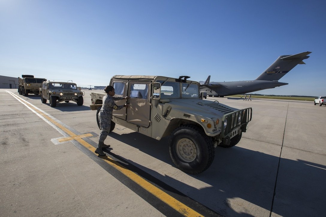 U.S. Air Force Senior Airman Krystin A. Springer-Ince, 35th Aerial Port Squadron, 514th Air Mobility Wing, exits a Humvee prior to it being loaded onto a U.S. Air Force C-17 Globemaster III during a joint mobility exercise with the 851st Transportation Detachment, U.S. Army Reserve, at Joint Base McGuire-Dix-Lakehurst, N.J., June 4, 2017. The aerial porters loaded two Humvees and a Heavy Expanded Mobility Tactical Truck Recovery Truck onboard a C-17, which is assigned to the 305th Air Mobility Wing and is maintained and flown by the 514th Air Mobility Wing, Air Force Reserve Command. (U.S. Air Force photo by Master Sgt. Mark C. Olsen/Released)
