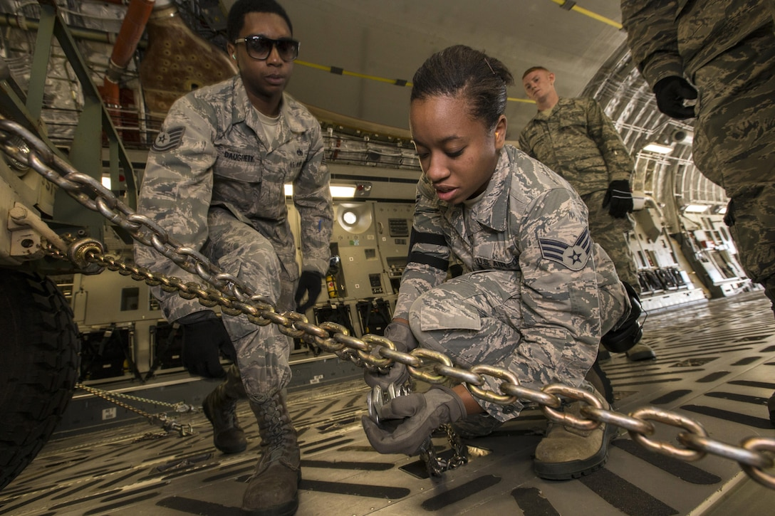 U.S. Air Force Aerial Porters Tech. Sgt. Horace A. Daughety, left, and Senior Airman Krystin A. Springer-Ince, both with the 35th Aerial Port Squadron, 514th Air Mobility Wing, chain down a Humvee during a joint mobility exercise with the 851st Transportation Detachment, U.S. Army Reserve, at Joint Base McGuire-Dix-Lakehurst, N.J., June 4, 2017. The aerial porters loaded two Humvees and a Heavy Expanded Mobility Tactical Truck Recovery Truck onboard a C-17, which is assigned to the 305th Air Mobility Wing and is maintained and flown by the 514th Air Mobility Wing, Air Force Reserve Command. (U.S. Air Force photo by Master Sgt. Mark C. Olsen/Released)