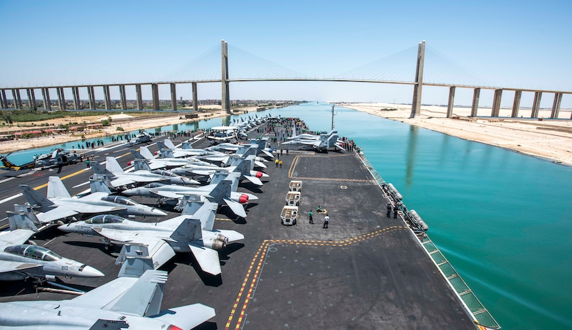 170605-N-YL257-053 SUEZ CANAL (June 5, 2017) The aircraft carrier USS George H.W. Bush (CVN 77) prepares to sail under the International Peace Bridge as it transits the Suez Canal. George H.W. Bush is deployed in the U.S. 5th Fleet area of operations in support of maritime security operations designed to reassure allies and partners, and preserve the freedom of navigation and the free flow of commerce in the region. (U.S. Navy photo by Mass Communication Specialist 2nd Class Christopher Gaines/Released)