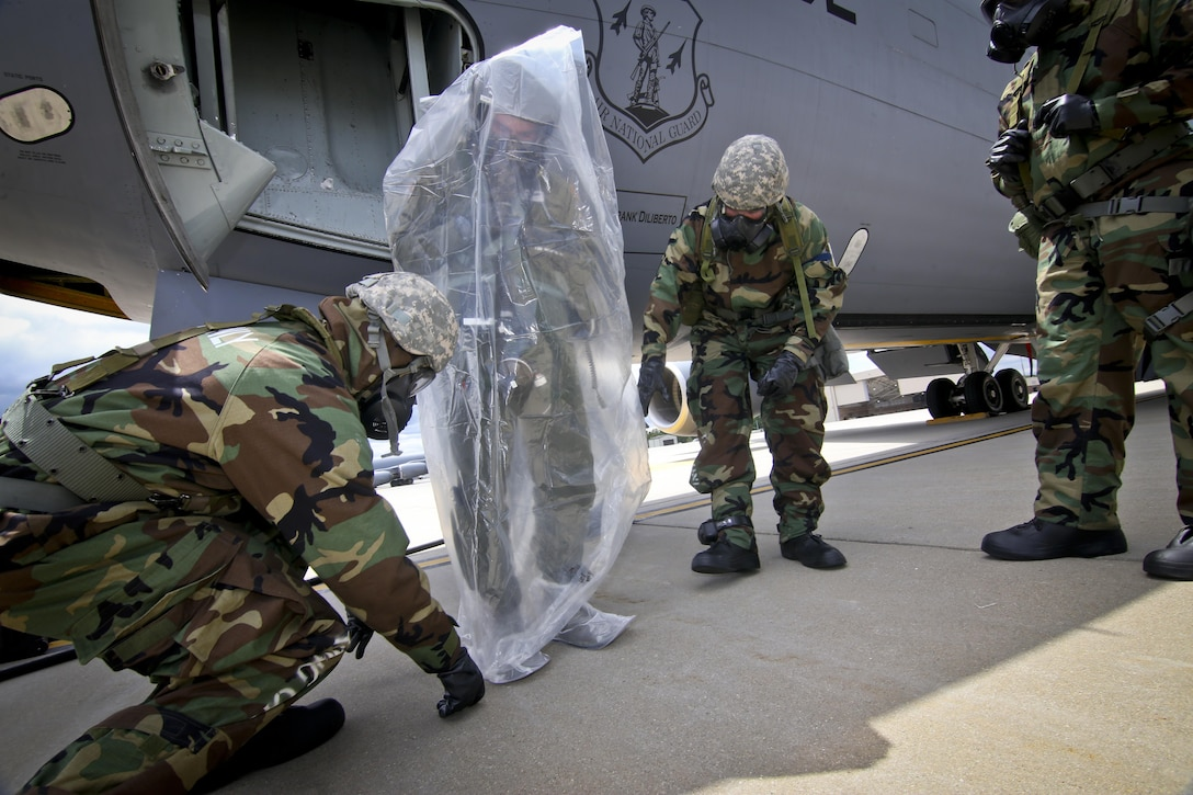 U.S. Air Force maintenance airmen from the New Jersey Air National Guard's 108th Wing place 1st Lt. Beau Deleon into a protective covering during an exercise at Joint Base McGuire-Dix-Lakehurst, N.J., June 7, 2017. Deleon is a KC-135 Stratotanker pilot with the 141st Air Refueling Squadron. (U.S. Air National Guard photo by Master Sgt. Matt Hecht/Released)
