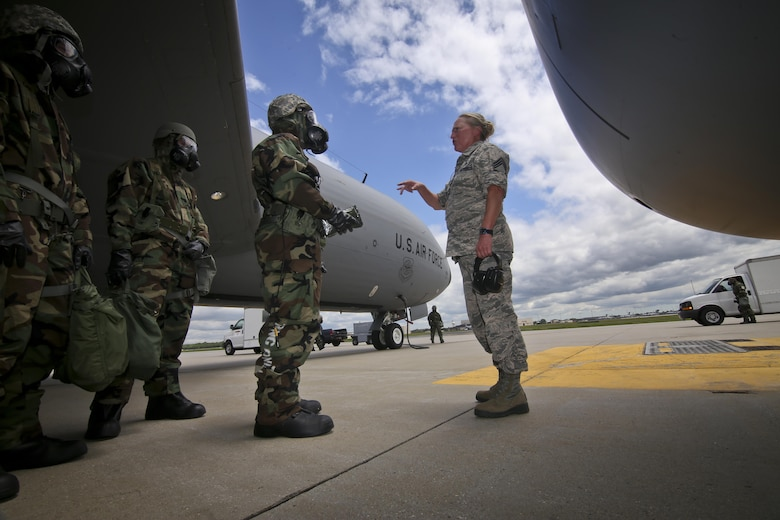U.S. Air Force Chief Master Sgt. Michele Evans, right, briefs 108th Wing maintenance airmen on aircraft decontamination procedures during an exercise at Joint Base McGuire-Dix-Lakehurst, N.J., June 7, 2017. (U.S. Air National Guard photo by Master Sgt. Matt Hecht/Released)