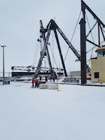 Crane Barge Paul Bunyan staging stop logs for sandblasting, structural repairs and painting for the MacArthur Lock dewatering bulkheads before the Lock closure in preparations for Soo Locks 2017 winter work. (U.S. Army Corps of Engineers, Detroit District Photo/Released).
