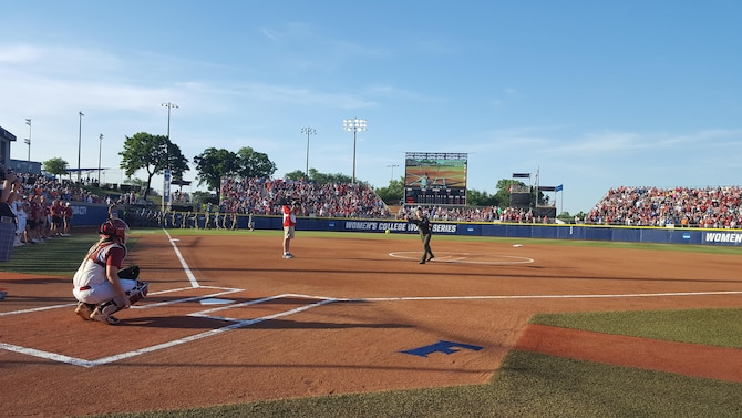 Staff Sgt. Danielle Warren, 344th Air Refueling Squadron KC-135 Stratotanker boom operator, throws the ceremonial first pitch at the NCAA Women's College World Series, June 6, 2017, at USA Softball Hall of Fame Stadium, OGE Energy Field, Oklahoma City, Oklahoma. The NCAA held a military appreciation night to thank service members and veterans for their service. (U.S. Air Force photo/2nd Lieutenant Carla Stefaniak)