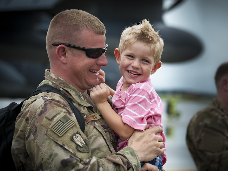 Senior Master Sgt. Jeffrey Schillawski, 71st Aircraft Maintenance Unit superintendent, embraces his son, Noah, during a redeployment, June 6, 2017, at Moody Air Force Base, Ga. The 41st and 71st Rescue Squadrons were recently deployed to Southwest Asia where they provided combat search and rescue capabilities in support of Operation Inherent Resolve. (U.S. Air Force photo by Airman 1st Class Lauren M. Sprunk)