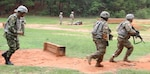 Colombian Sgt. Maj. Carlos Antonio Casio (left) gives chase during a buddy team live fire movement drill May 24 at Fort Jackson, S.C.. The teams performing the exercise were drill sergeant cadets graduating from the academy June 7.