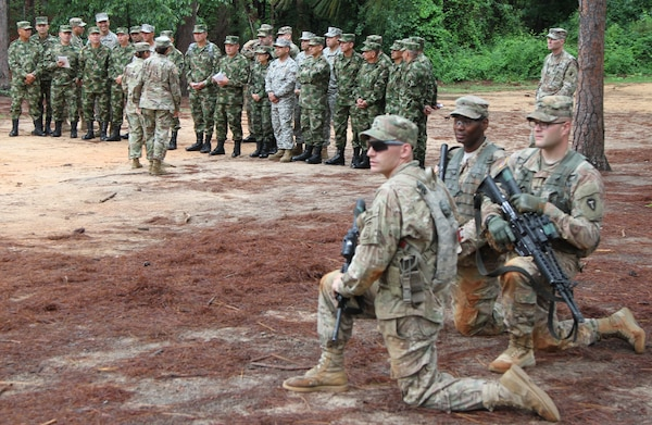 Colombian sergeants major receive safety brief and explanation of the buddy team live fire movement as drill sergeant cadets perform dry run at Fort Jackson, S.C., June 7.