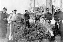 Enlisted, various uniforms, USRC Bear crewmen, coaling ship, circa 1895