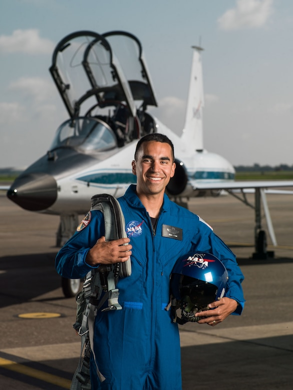 Air Force Lt. Col. Raja Chari stands in front of an NASA T-38 Talon supersonic trainer aircraft at Ellington Field in Houston, Texas, June 6, 2017. Chari has been selected to join the 2017 NASA Astronaut Candidate Class. NASA photo by Robert Markowitz