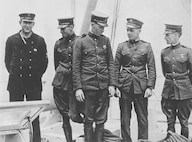 The crew of the NC-4, in Lisbon (Left to Right): Chief Machinist's Mate Eugene S. Rhoads, USN; LT James L. Breese, USN; LTJG Walter Hinton, USN; LT Elmer Stone, USCG; LCDR A.C. Read, Commanding Officer, NC-4.  Missing from photo is ENS Herbert C. Rodd, USN.