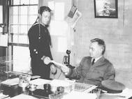 CDR Stone at his desk as the commanding officer of Air Station Cape May, circa 1933.   U.S. Coast Guard Photo No. G-APA-10-15-73 (17).