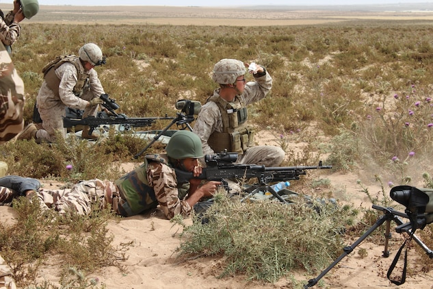TIFNIT, Morocco - U.S. Marines instruct their counterparts from the Royal Moroccan Armed Forces on proper weapons techniques during Exercise African Lion 2017. African Lion is a combined, multilateral exercise designed to improve interoperability and mutual understanding of each nation's tactics, techniques and procedures while demonstrating the strong bond between the nation's militaries. (Photo by Thomas Flatley)