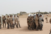 TIFNIT, Morocco - Multinational platoons consisting of personnel from the Moroccan Armed Forces, U.S. Marines and U.S. Army practice riot-control techniques at the training area in Tifnit, Morocco during Exercise African Lion 2017. African Lion is a combined, multilateral exercise designed to improve interoperability and mutual understanding of each nation's tactics, techniques and procedures while demonstrating the strong bond between the nation's militaries. (Photo by Thomas Flatley)
