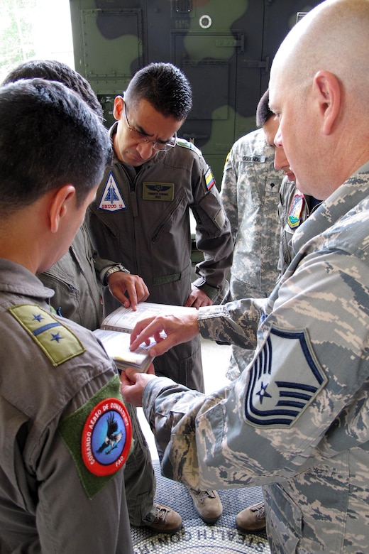 Members of the Colombian Air Force discuss training plans for U.S. Air Force Controllers during a visit with the Georgia Air National Guard's 117th Air Control Squadron at Hunter Army Airfield in Savannah, Georgia during a State Partnership Program Subject Matter Expert Exchange on Ground Control Intercept, May 30-June 2, 2017. During the weeklong engagement the Colombians worked with Air Controllers from 117th shaping Colombian Air Force training plans by pairing experts together to exchange ideas. The Georgia Air National Guard supported the South Carolina National Guard's State Partnership Program during the engagement. (U.S. Air National Guard photo by Capt. Stephen D. Hudson)