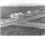 "Air Station Annette, Alaska Original photo caption: ""USCG Air Station, Annette Isl., Alaska, Inspection -- Admiral E. J. Roland, USCG, Commandant, dedicating new family quarters.""; photo dated 28 July 1965; Photo No. CPI-072865-04; photo by PH1 Nicols."
