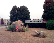 """Air Station Cape Cod, Massachusetts Original photo caption: """"The entrance to the Coast Guard Air Station Cape Cod.  The Air Station is located on Otis Air Force Base.""""; photo is dated 24 July 1999; photo number 990724-I-9954-500 (FR); photo by PA3 Bridget Hieronymus, USCG."""