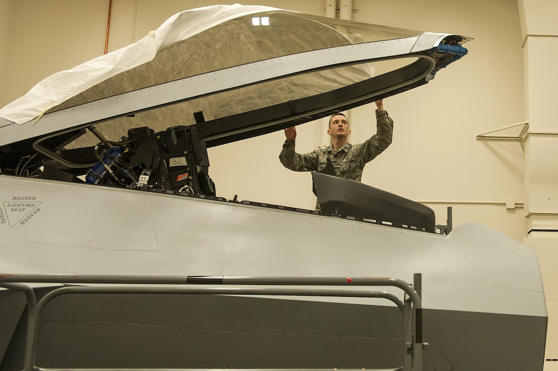 U.S. Air Force Tech. Sgt. Jeremy Finley, F-22 Raptor crew chief instructor at the 372nd Training Squadron, Detachment 14, prepares the canopy of an F-22 Raptor simulator at Joint Base Elmendorf-Richardson, Alaska, June 7, 2017.  Det. 14 is part of the Air Education and Training Command's 82nd Training Wing out of Sheppard Air Force base in Wichita Falls, Texas.