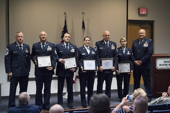 Graduates from the Community College of the Air Force pose for a photo with 130th Airlift Wing commander Col. Johnny Ryan (far right) and Command Chief Master Sgt. Kevin Cecil (far left) June 4, 2017 following a graduation recognition ceremony held at McLaughlin Air National Guard Base, Charleston, W.Va. Five members of the 130th AW recently completed their CCAF degrees and were lauded for their accomplishments at the graduation recognition ceremony. (U.S. Air National Guard photo by Capt. Holli Nelson)