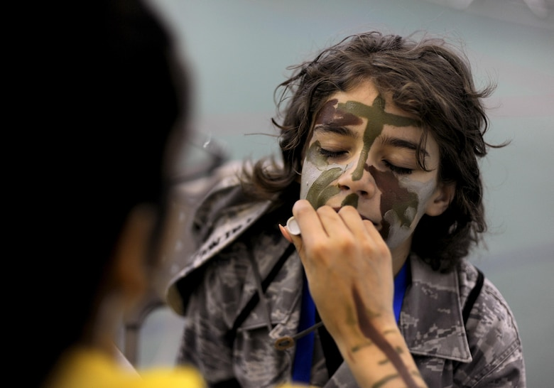 Parker Trujillo gets his face painted during the Operation Heroes event at Minot Air Force Base, N.D., June 3, 2017. Operation Heroes is an annual event that gives kids the experience of what their parents go through when they deploy. (U.S. Air Force Photo by Staff Sgt. Chad Trujillo)