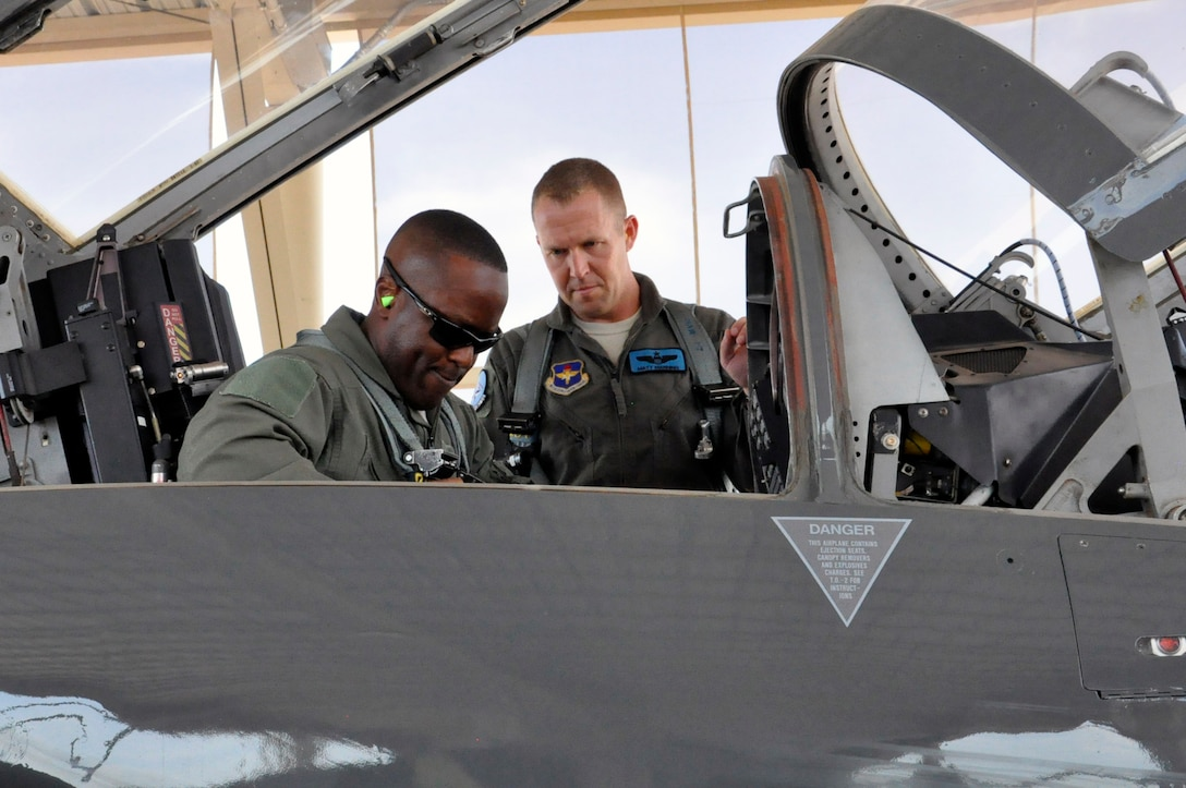 Brig. Gen. Ronald Jolly, 82nd Training Wing commander, straps into a T-38 Talon with the help of Lt. Col. Matthew Manning at Sheppard Air Force Base, June 8, 2017. Sheppard's 80th Flying Training Wing is home to the Euro-Nato Joint Jet Pilot Training program, the world's only pilot training program for the NATO alliance. (U.S. Air Force photo by Debi Smith)