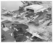 """Air Station Clearwater, Florida (Formerly Air Station St. Petersburg) Original caption reads: """"The personnel, planes, and equipment of the U.S. Coast Guard Air Station, St. Petersburg, Fla. are shown at a recent personnel and station inspection. The Coast Guard's search and rescue services from St. Petersburg provide protection to shipping and small craft in offshore and inland waters of the southeastern United States (St. Petersburg Times photograph)""""; January, 1955; photo by Johnnie Evans."""