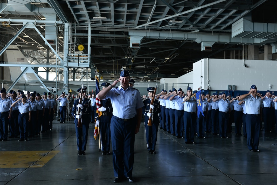 Col. David Berg, 55th Wing vice commander, leads a formation during the 55th Wing change of command ceremony in Dock 1 of the Bennie Davis Maintenance Facility on Offutt Air Force Base, Neb., June 8. The Fightin' Fifty-Fifth said farewell to Col. Marty Reynolds and welcomed Col. Michael Manion.