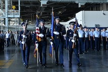 The Honor Guard presents the colors during the 55th Wing change of command ceremony in Dock 1 of the Bennie Davis Maintenance Facility on Offutt Air Force Base, Neb., June 8. The Fightin' Fifty-Fifth said farewell to Col. Marty Reynolds and welcomed Col. Michael Manion.