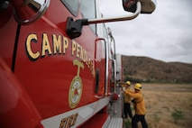 Firefighters from the Camp Pendleton Fire Department pack the firetruck up after participating in Wildland Fire Fighting Exercise 2016, near Pulgas Lake on Camp Pendleton, Calif., May 5, 2016. Wildland Firefighting Exercise 2016 is part of an annual training exercise to simulate the firefighting efforts by aviation and ground assets from the Navy, Marine Corps, San Diego County and CAL Fire. This event is aimed at bringing awareness to this joint capability while also exercising the pilots and operators who conduct firefighting missions.(U.S. Marine Corps photo by Cpl. Brian Bekkala/MCIWEST-MCB CamPen Combat Camera/Released)