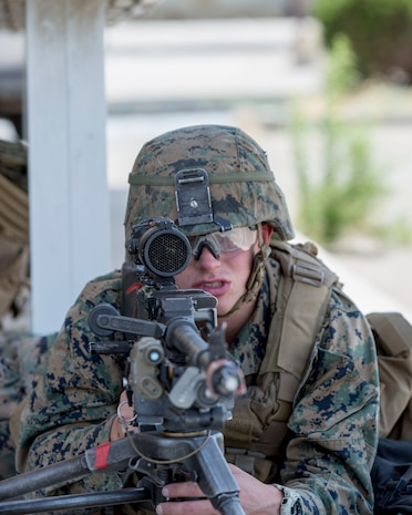 Private First Class Noah Perkins, a machinegunner with 1st Battalion, 5th Marines, holds his position during a training exercise aboard Marine Corps Logistics Barstow, June 6.