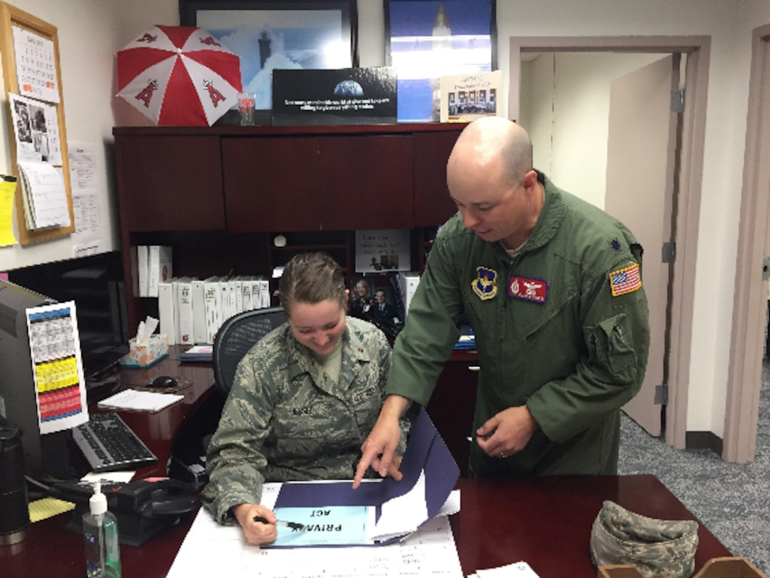 2nd Lt. Sarah Jessee, 532nd Training Squadron casual status lieutenant, works with Lt. Col. William Weiford, 532nd TRS director of operations, June 1, 2017, Vandenberg Air Force Base, Calif. For the past 30 years a small percentage of officers arrive at the 381st Training Group, for technical training, without a security clearance which prevents them from starting classes. (courtesy photo)