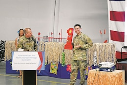 Lt. Col. Alexander Murray, left, 1st Infantry Division acting chief of staff, presents Col. John Melton, commander of Irwin Army Community Hospital, with a token of appreciation after Melton spoke at the Asian-American and Pacific Islander Heritage Month observance May 19 at the Warrior Transition Battalion clamshell.