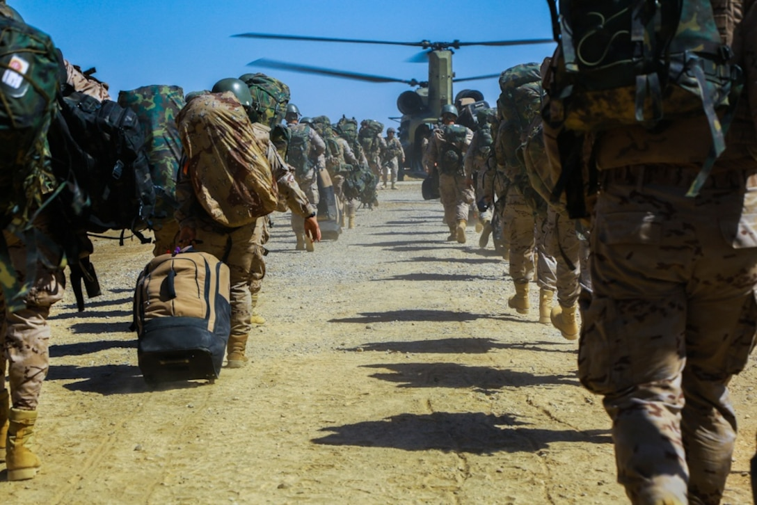 Spanish trainers load a CH-47 Chinook helicopter after spending six months in Iraq at the Besmaya Range Complex, training Iraqi security forces in support of Combined Joint Task Force Operation Inherent Resolve, May 9, 2017. Training at building partner capacity sites is an integral part of the effort to train Iraqi security forces personnel to defeat the Islamic State of Iraq and Shyria. CJTF-OIR is the global coalition to defeat ISIS in Iraq and Syria. Army photo by Spc. William Gibson